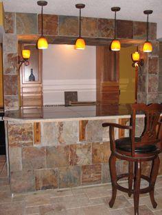 basement bar ideas through wall | Basement bar, Basement bar still in process. Slate wall tiles ...