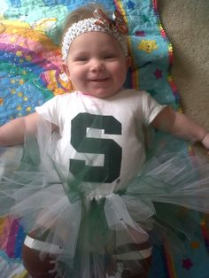 A smiley Spartan in her green and white tutu :)