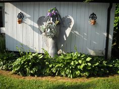 Garden angel made from old metal roofing.