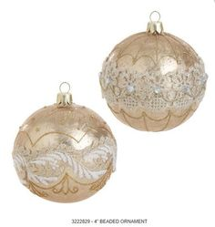 """4"""" Gold Glass Ball Ornaments; Look and the decorations on these ornaments, they're so detailed!  So beautiful!      2 Asst with soft gold color--pearl-like, matte finish     Glittered gold designs are painted on the ornaments     On Style A a lacy design in gold and white circles the diameter of the ball.     Style B has a lacy design with gems around the ball     Made of Glass    Measures 4"""""""