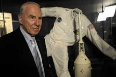 Jim Lovell poses with his Apollo 13 spacesuit at the 40th Anniversary reunion in Chicago.