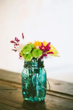 Inspired by the mason jars at Katie and Seth's wedding, find vintage jade and turquoise jars
