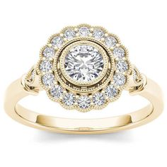 1/2 CT. T.W. Diamond Flower Halo 10K Yellow Gold Engagement Ring ($2,750) ❤ liked on Polyvore featuring jewelry, rings, round diamond ring, flower diamond ring, yellow gold engagement rings, flower engagement ring and bezel set diamond ring