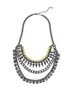 The new mark. Hang Tough Necklace features neon yellow faux-stones, hematite-colored chains and smoky rhinestones and spikes to add a pop of pretty to your outfit! #AvonRep