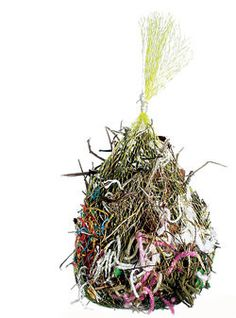 A mesh produce bag filled with non-synthetic yarns, feathers, and grasses will help your songbirds with their spring nest-building.