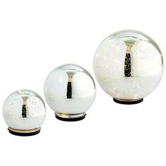 Twinkling Light Spheres - these handcrafted mercury glass are batter-operated, glowing and shimmering, creating a magical and enchanted setting to your evenings!  Also great Hostess gifts for that special event.