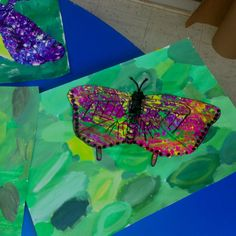 Butterflies on painted paper with green color mixing