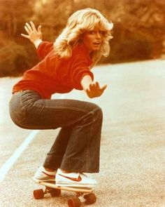 Farrah Fawcett skateboarding in sweet Nikes.