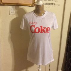 Enjoy Coke high low Tee Cutest enjoy coke T-shirt a bit Hilow hemline very comfy semi fitted. 63% polyester 37% rayon. Jerry Leigh Tops Tees - Short Sleeve