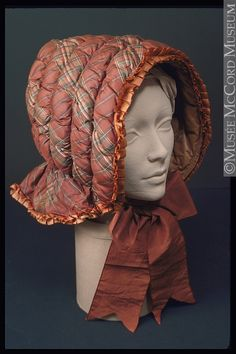 Winter bonnet, materials not listed (appears to be with unclear stuffing), c. 1850.