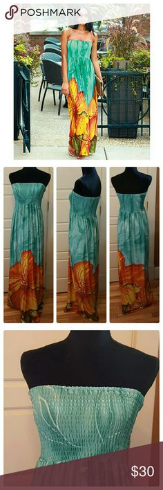 "Strapless Maxi Dress NWOT Teal/Orange Maxi dress. Strapless, smocked elastic stitching on chest area. Tag says XL.  But will fit upto a 2x. Dress is very long. Never worn only tried on.  Only selling because it is far too long  for my short 5'2"" height and prefer dress with sleeves/straps. Measurements taken laying flat. Armpit to armpit 13.5"" unstretched. Length: 53"". Dresses Maxi"