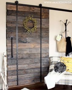 These 15 unique barn door styles offer a variety of ways to work this hot design trend into any home decor. Find the barn door style that best suits your home and get the look today! Wood Barn Door, Barn Door Track, Diy Barn Door, Wood Doors, Farm Door, Metal Barn, Interior Sliding Barn Doors, Sliding Barn Door Hardware, Sliding Glass Door