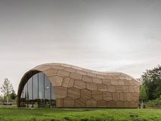 A peanut shell-shaped wooden pavilion is the first full size prototype for a robotic prefab building system, created by a team from the university fo Stuttgart.