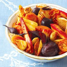 "Kathy Osterweill made for Easter 2014-Roast Vegetable Tsimmes with Apricots Tsimmes means ""a fuss"" in Yiddish, but that doesn't happen with this easy recipe. In the pan, separate the beets from the sweet potatoes and parsnips to prevent discoloration."
