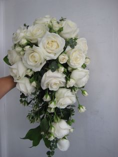 a trailing shower bouquet with ivory spray roses and ivory avalanche roses