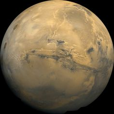 The largest canyon in the Solar System cuts a wide swath across the face of Mars. Named Valles Marineris, the grand valley extends over 3,000 kilometers long, spans as much as 600 kilometers across, and delves as much as 8 kilometers deep. - Image Credit: Viking Project, USGS, NASA