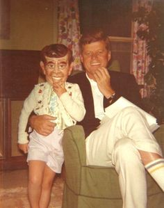 Caroline posing with her father (JFK), while on vacation in Hyannis Port (1962). For the record: That mask is HORRIFYING! | Hilarious (And Slightly Frightening) Photo Of Caroline Kennedy With President Kennedy