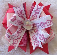 http://www.facebook.com/pages/Spoiled-Rotten-Cotton-Boutique/132728380133473  Personalize ribbon with t-shirt transfer paper!