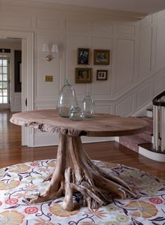 Groundwork Root base centerhall table made of reclaimed cedar tree stump with natural edge wood top.