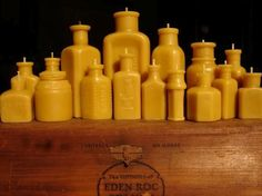 Beeswax candles - poured into antique bottles
