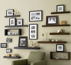 Multiple ledges and photos on a wall. Archetype Espresso 2' Ledge: Crate $29.95.