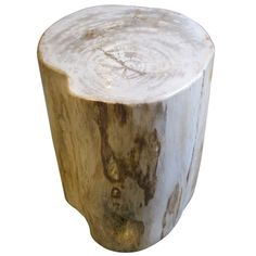 Indonesian petrified wood cream side table. www.balsamoantiques.com