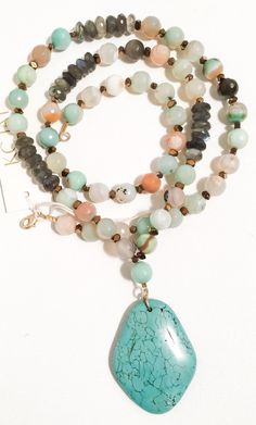 A personal favorite from my Etsy shop https://www.etsy.com/listing/261557472/turquoise-stone-pendant-on-amazonite-and