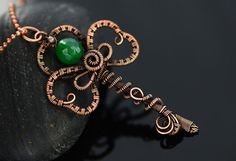Handmade Celtic copper key pendant with lots of intricate details and emerald gemstone. This unique pendant is lovingly made from many meters of