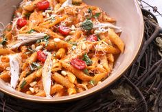 Roasted Red Pepper and Basil Penne:  4 cloves garlic  1/3 cup pine nuts  1/3 cup freshly grated Parmesan  1 cup of jarred roasted red bell peppers  1 cup fresh basil leaves  salt and pepper  1/3 cup extra virgin olive oil  1 pound penne pasta  1/2 cup heavy cream  roasted rotisserie chicken, optional