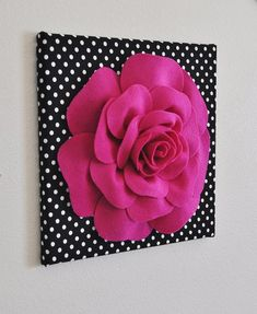 ALL Home Decor ITEMS ARE MADE TO ORDER PLEASE SEE SHOP FOR CURRENT CREATION TIME!!! Large Fuchsia Rose Flower on Black and White Polka Dot Canvas 12 x12 Wall Hanging. ***Matching and Coordinating Pillows Available Please see Shop: https://www.etsy.com/shop/bedbuggs Stunning Touch to any