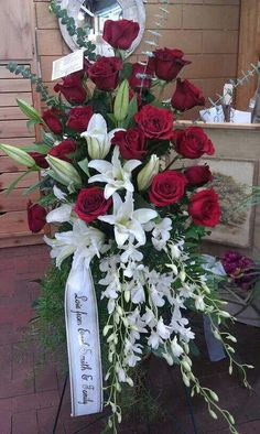 Funeral Tribute Standing Spray Our most popular funeral spray! A gorgeous tribute of red roses, white lilies and white orchids with a cus… Funeral Floral Arrangements, Church Flower Arrangements, Funeral Flowers, Wedding Flowers, Pretty Flowers, Silk Flowers, Funeral Sprays, Funeral Tributes, Memorial Flowers