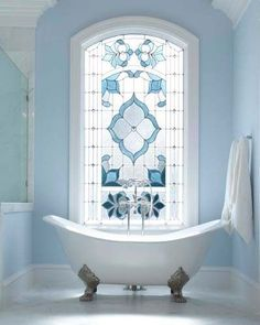 Stained glass window in the bathroom.