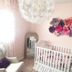 For the love of floral. These DIY'd paper flowers were created for a baby shower and repurposed in the nursery. via @thealdermanfive!