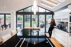 Thanks to an ambitious and well-designed rear extension, Penny and Douglas Dawson have transformed the way their family home works – Kitcapfix House Extension Design, Glass Extension, Roof Extension, House Design, Extension Ideas, Extension Google, Kitchen Extension With Pitched Roof, Kitchen Extension Sliding Doors, Bungalow Extensions