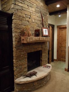 Timberline Framers Inc, Pagosa Springs, Colorado. Barrone Residence Stone fireplace with a timber mantle.