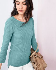 The soft (and fun) feel of textured jersey-knit cashmere gives yet another reason to love the softest fiber in the world. Designed to flatter, thanks to a sophisticated boat neckline, three-quarter sleeves, and a high-low hem.
