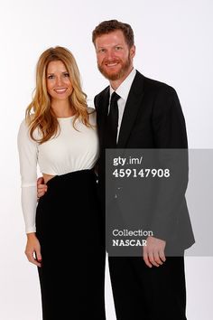 News Photo : Amy Reimann and Dale Earnhardt Jr pose for a...
