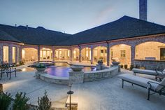 Open patio space // Pool and spa with water features