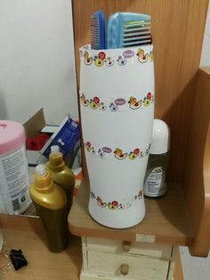 Diy Comb stand   It's as simple as it looks, just cut open an old shampoo bottle and use some of ur favourite washi tape and use it to store anything.
