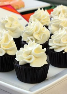 Mini Black & White cupcakes! The only thing is, is that black cake usually makes your mouth black!