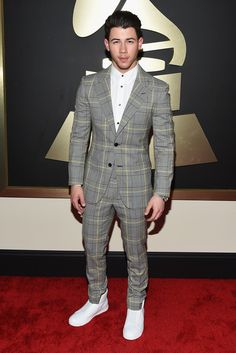 Nick Jonas in Versace on the Red Carpet at the 2015 Grammy Awards [Photo by Getty Images]