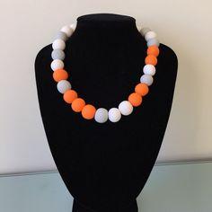 Big jewellery. Bold necklace. Orange, grey and white statement necklace. Big bold large design. Chunky round beads.