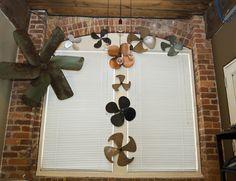 My graveyard of fan blades - aka my office. They make funky decor!