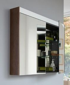 With a luminosity of at least 300 lux, the mirror cabinet with LED light band guarantees the user a perfect and uniform illumination. Cabinet sides to match the furniture finishes, here a vanity unit and tall cabinet in Chestnut Dark. Bathroom Spa, Family Bathroom, Modern Bathroom, Duravit, Mirror Cabinets, Storage Cabinets, Mini Bad, Creative Storage, Vanity Units