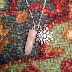 """Rose Quartz Sun Silver Necklace Beautiful handmade necklace featuring a sun charm and a natural stone rose quartz crystal pendant. Comes on 18"""" 925 sterling silver chain with lobster clamp. In perfect condition! Jewelry Necklaces"""