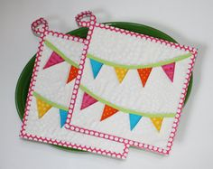 kitchen want.  potholders!  red/lime/aqua potholders in any fun theme: gnomes, trees, peacocks, birdies, kites, banners, tattoos, catholic insignia, flowers, etc, etc