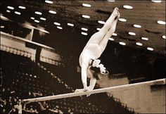 Gymnast Elena Mukhina performing pirouette on uneven bars (1979).