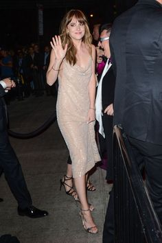 At the Met Gala after-party in a slip dress.