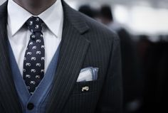 BLues: Suit layered over cardigan.