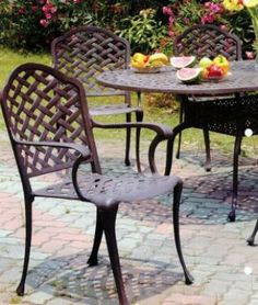 What A Beautiul Finish The Cast Iron Patio Furniture Has   The Garden Is A  Pretty